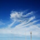Streetlights, Clouds and a Blue Sky by Janet Leadbeater