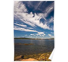 Winter Harbor Lighthouse under a Blue Sky and White Clouds Poster