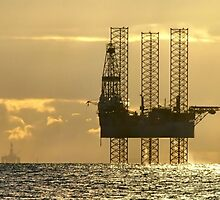 Two Rigs in the Morning sun by Calum Davidson