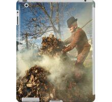 Old farmer burning dead leaves iPad Case/Skin