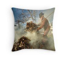 Old farmer burning dead leaves Throw Pillow