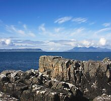 Eigg and Rhum from Mallaig. by John Cameron