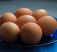 Eggs on a plate by Greg Birkett