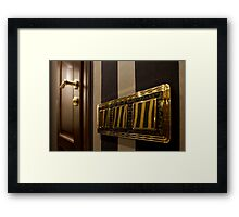golden button Light Switch Framed Print