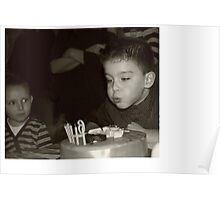Birthday boy blowing out candles Poster