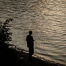 Silhouette Of A Fisherman by Mary Carol Story
