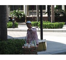 Man selling coconut drink in Ho Chi Minh Photographic Print
