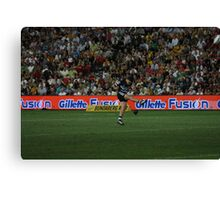 Kicking the Ball Canvas Print
