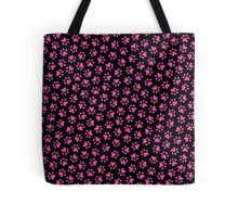 Hot pink paw prints on black background Tote Bag