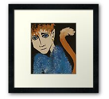 Demon on a black sand beach Framed Print
