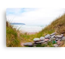 stone wall shelter on a beautiful Irish beach Canvas Print