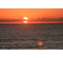 The Sun Descends Behind the Clouds Photographic Print