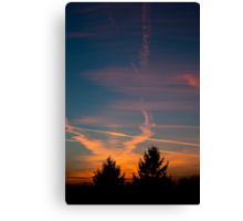 Evening aeroplane contrails sunset Canvas Print