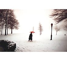 Lady walking through Central Park in snowstorm Photographic Print