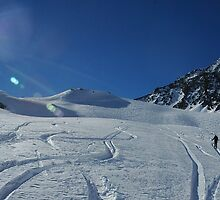Hiking past ski tracks, Val d'Isere by Peak Photographics