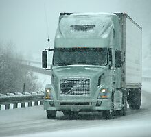 Trucks on winter highway during snowstorm, by cascoly