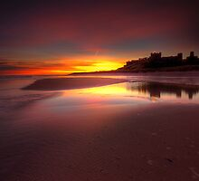 SUNRISE AT BAMBURGH BEACH. by STEVE  BOOTE