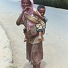 Young Woman Carrying a Child by Laurel Talabere