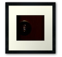 Key in a key hole Framed Print