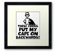 These fools put my cape on backwards Framed Print
