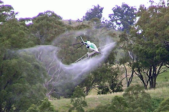 Helicopter Weed Spraying by Hummingbyrd