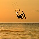 Silhouette of a kitesurf, a flying above water of a gulf by Sergey Sukhorukov