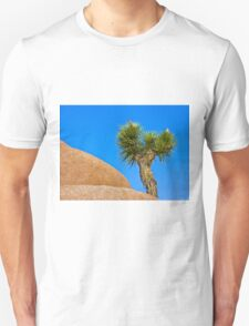 Joshua tree on granite under blue skies T-Shirt