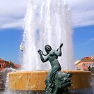 Magnificent fountain and statue by daffodil
