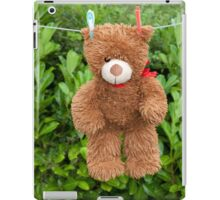 toy brown teddy bear hanging on line iPad Case/Skin
