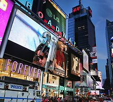 The lights of Times Square at twilight, NYC by Reinvention