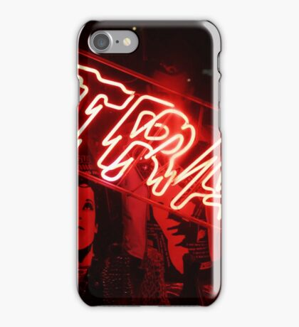 """Red neon light sign of a store called """"Trash"""" in the Lower East Side  iPhone Case/Skin"""