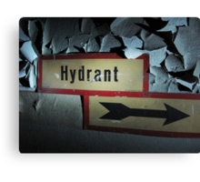 Hydrant sign on a worn out wall with paint peeling Canvas Print