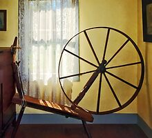 Large Spinning Wheel Near Lace Curtain by Susan Savad
