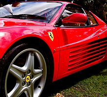 red ferrari by Robert Munden