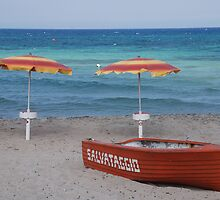 Lifeboat and Two Beach Umbrellas  by jojobob