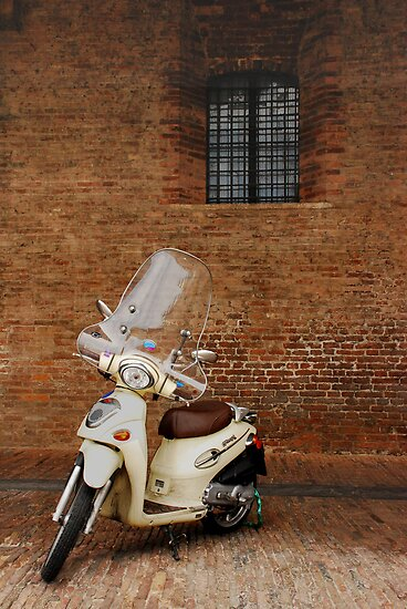 White Scooter Against Brick Wall  by jojobob