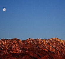 San Jacinto Mountains Sunrise with Moon Setting in the West by Roger Passman