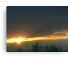 Sunrise through the clouds Canvas Print