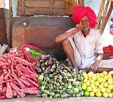Bundi market vegetable seller by Jeff Barnard