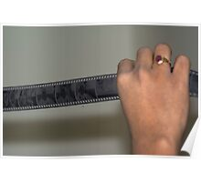Person holding a strip of photo negatives Poster