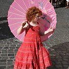 Pink parasol girl by Nancy Huenergardt