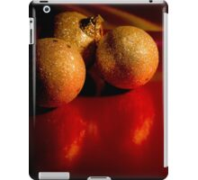 Christmas golden baubles on red background iPad Case/Skin