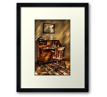 A chair and a desk Framed Print