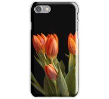 Orange tulips against black background iPhone Case/Skin