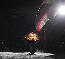 Paragliding in the night by Elena Martinello
