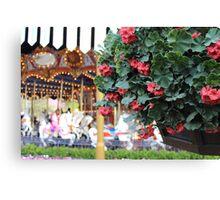 Flowers around King Arthur's Carousel  Canvas Print