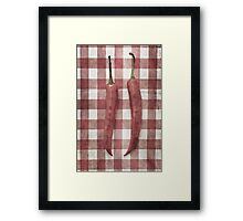 Still life of two red chili peppers Framed Print