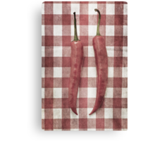 Still life of two red chili peppers Canvas Print