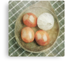 Still life of red plum tomatoes and garlic Canvas Print