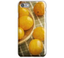 Yellow plum tomatoes on a wooden spoon iPhone Case/Skin
